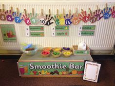 Maths interactive display - smoothie bar using resources from twinkl dramat Early Years Maths, Early Years Classroom, Smoothie Bar, School Displays, Classroom Displays, Classroom Ideas, Play Based Learning, Fun Learning, Preschool Curriculum