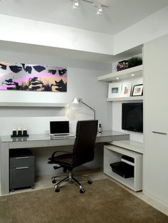 I like the lack of clutter, impression of organisation, shelves and the idea of large prints on the wall.
