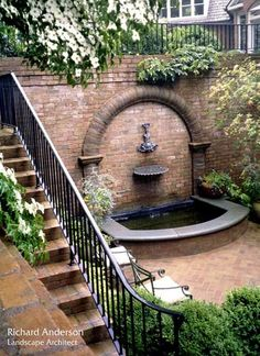 Stairs to secret garden courtyard with fountain.