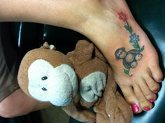 My latest tattoo !!! My monkey fav monkey .. Blue flower for him and pink one for me