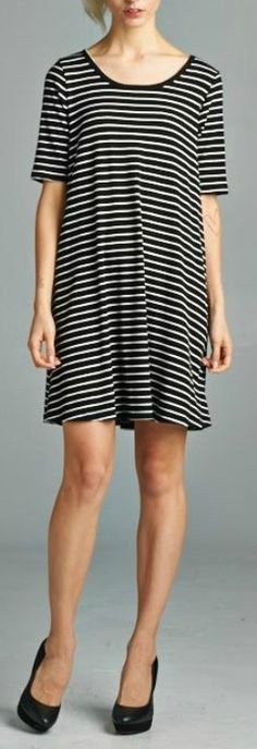 Dress with striped style. Ribbed fabric A-line dress. Drapes well. Super soft. Loose fit. 84% Rayon, 8% Polyester, 8% Spandex. Made in USA.