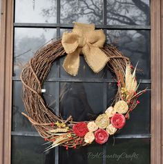 Pretty and simple fall wreath with fabric flowers and floral picks.