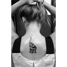 elephant trunk up tattoo