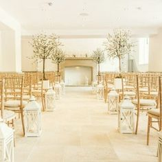 This pretty magical ceremony room is at Tyn Dwr Hall wedding venue in #Wales #UK #weddingvenues #ceremonyroom #trees #weddingstyle #wedding #aisle #weddingchairs #weddingceremony #fireplace #lanterns #hurricanelantern #white {http://buff.ly/2e3lPKn}