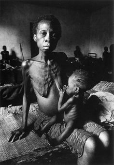 The effects of war : Don McCullin's photograph of a 24 year old mother, starving along with her baby in Biafra, 1970s.