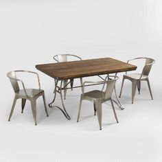Our Jackson Rectangular Table with Metal Base boasts the sturdy appeal of vintage industrial furniture popular in the early 20th century. Its slender, sculptural silhouette includes curved metal legs and a slat-style tabletop that features tongue and groove acacia wood construction.