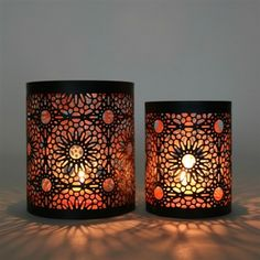 Set of 2 metal candle holders featuring a striking laser cut design. When lit the design creates a serene shadow that instantly makes the room cozy and inviting. These candle holders are perfect for all occasions and can be used in any room. Glass Votive Candle Holders, Candle Holder Set, Votive Candles, Tea Lights, Lanterns, Lazer Cut, Cozy, Design, Design Comics