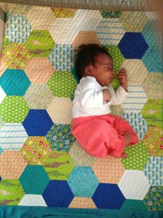 Grand baby Luna on quilt made by me Grand ma