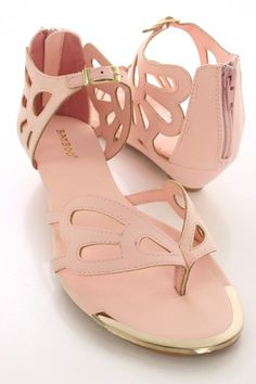 Look perfectly pretty for your next party when you add these saucy sandals to your look! The features include a smooth faux leather upper with a thong post, cut out detailing, buckle accent, stitched detailing, high polish metal toe trim, back zipper closure, smooth lining, and cushioned footbed. Approximately 1 inch low wedge heels.