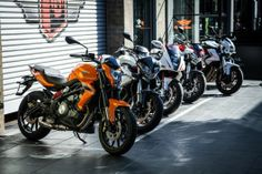The Benelli BN302 in front of a murderer's row of stablemates, including the TnT 1130 (Pho...