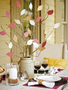 Take the kids for a stroll outdoors to gather bare branches to fill with colorful card-stock leaves for this easy  centerpiece.