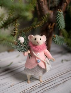 This little mouse was hand made by wool using needle felted techniques. It holds standing alone just have to adjust the foot and tail. The hands and the legs can be moved in different positions, also the head can be turned in both directions. It comes with a pink coat, gray skirt,