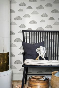 Decorative clouds drift across beautiful, calm walls on this simple hand drawn wallpaper.
