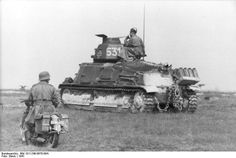 Germans using a captured French Sumoa_S-35 tank, France 1941.