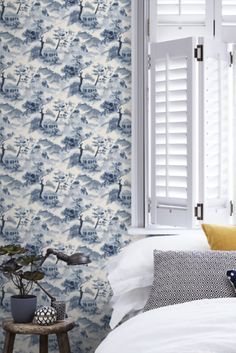 Delicate water colour effect brush strokes fill this design with gentle style, showcasing a charming oriental-style landscape filled with beautiful trees and traditional houses. Head over to WallpaperDirect now to see the complete collection now