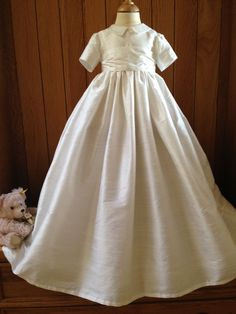 A simply gorgeous silk dupion christening gown which is suitable for a boy  or girl – perfect as an heirloom baptism gown. Shown here in ivory raw silk  ... 1504eb1f9