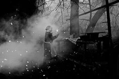 A Mari woman making a fire in a sacred grove in Russia. »« by Tatiana Plotnikova in the New York Times