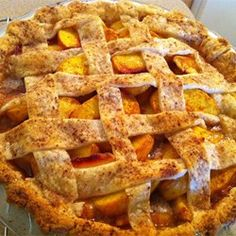 Peach Pie - Allrecipes.com; baked an extra ten minutes and left in oven to cool. To peel peaches, boil for 1-2 min then plunge in cold water.