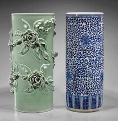Two Chinese Porcelain Umbrella Stands, blue and white with scrolling passion flower motif and lingzhi to rim; together with celadon glazed with moulded roses; H: 28""