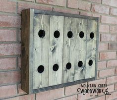Rustic 10-Bottle Wall Wine Rack  Handmade in the USA out of Georgia White Pine and lightly stained in select finishes, this wine rack measures 19.0 x 15.75 x 3.5 and can accommodate up to 10 bottles. All edges are routed and all surfaces sanded for a smooth finish. Includes 2 metal hangers pre-mounted on each side. Proudly display this handmade, high quality creation instead of a factory produced fake!  We keep these racks in stock and ready for speedy shipping.  Perfect for wedding, shower…