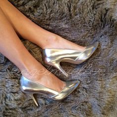 """Silver heels Super cute silver pumps, only worn a few times. Some dings, shown in pictures. Stains on the inside. Pointy toes. Length: 11"""", width: 3.5"""", heel height: 4.25"""". Christian Siriano for Payless. Christian Siriano Shoes Heels"""