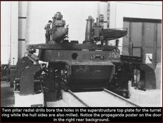 Production of Tiger I at Henschel factory: Twin pillar radial drills bore the holes in the superstructure top plate for the turret ring while the hull sides are also milled. Notice the propaganda poster on the door in the right rear background