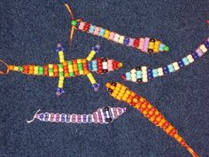 The kids' cousins went to camp this year and taught DD and LD how to make these pony-bead snakes and lizards.  I thought t...