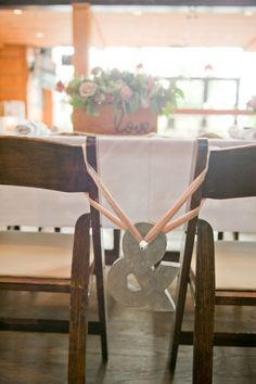 & ampersand wedding table bride groom cute pictures from behind chairs rustic country decoration