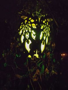 """Leaf Wings Lantern"" in green, amber, and warm white.  new wood cut lantern available on my website now... www.lightcraft.design"