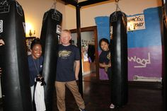The Garrett Popcorn team having fun with the punching bags!