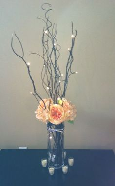 Flowers and Lighted Branches :  wedding centerpiece lighted branches orange orange flowers reception Centerpiece1