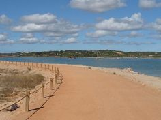 Alvor Boardwalk in Algarve, Portugal- miles of wooden boardwalk on the beach to see the coastline in a wheelchair