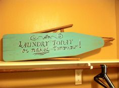 Vintage ironing board painted for the laundry room. Love it!