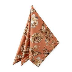 Enhance the beauty of your dining table with the luxurious Williamsburg Napkin. In rich copper, this elegant damask napkin features an exquisite Jacobean floral, creating a lovely addition to any table setting.