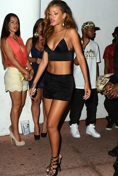 @Rihanna was spotted leaving Cameo nightclub in an Alexander Wang satin short and crop top set, and her favorite Tom Ford lace-up gladiator sandals.