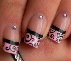 Pink French manicure tips with nude nails, black swirls & pink crystals free hand nail art