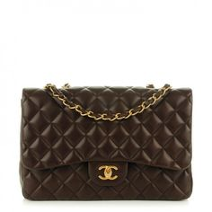 This is an authentic CHANEL Lambskin Quilted Jumbo Single Flap in Dark Brown. This is a stylish Chanel flap bag that is crafted of luxuriously soft diamond-quilted lambskin leather in chocolate brown.