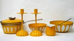 Vintage yellow mid-century enamelware (part of larger vintage kitchenware collection).