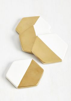 These ceramic coasters may be beneath your drink, but they're above average in excellent style! White hexagons are halved with metallic gold paint, looking contemporary and chic while they conserve your tabletop from condensation.