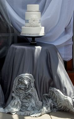 Love everything about this picture...from the cake to the linens its all beautiful!