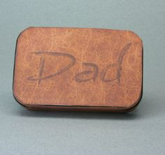 An Altoids tin for a collection of miniatures for Dad covered with printable faux leather covering.