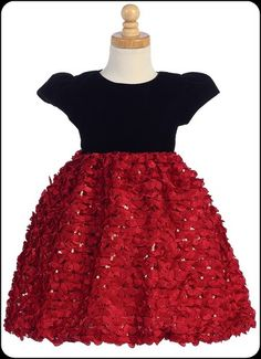 A flurry of delicate ribbons define this enchanting red holiday dress with a cap sleeve, black velvet bodice, tie back sash and a skirt that is adorned with shimmering sequins.   A lovely choice for her holiday and Christmas events.