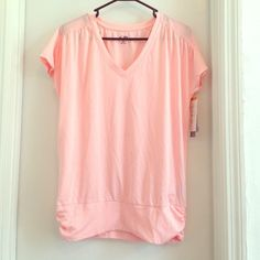 Yoga/workout top Loose fitting top but gets tighter at the bottom where it's cinched Champion Tops