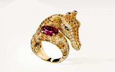 Boucheron Zarafah ring, set with rubies, blue sapphires, orange sapphires, brown diamonds and white diamonds