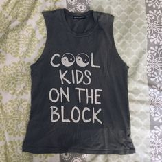 "Brandy Melville Cool Kids Top Brandy Melville ""cool kids on the block"" raisa(?) tank top. Bought it from pacsun but it's Brandy Melville. No flaws, great condition. The filter makes it look a lot darker than it really is  Brandy Melville Tops"