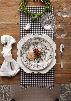 black and white napkins on white linens.  striped maybe?