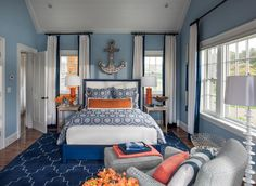 New HGTV 2015 Dream House with Designer Sources  This bedroom is full of personality and fun! It displays a classic nautical theme with a modern twist. Blue and orange hues, as well as geometric shapes, are repeated in the wool rug and bedding, while vaulted bead board ceilings and floor-to-ceiling drapery expand the space for an open and airy feel.