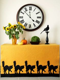 This no-sew tablecloth couldn't be easier to make. Download our pattern and cut out scaredy-cat shapes from black felt. Then simply attach them to a large piece of gold felt using fusible web.  Download the Scaredy-Cat Pattern