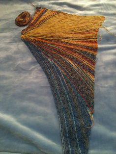 "Ravelry: getzengirl47s Sunny Sunstruck ... then click thru to full pattern details ""An asymmetrical triangular garter stitch shawl knit in at least 2 but as many as 13 colors. Pattern includes spreadsheets that you can download with row-by-row stitch counts for each section. PDF $6 USD"