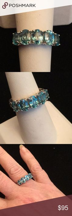 Genuine Caribbean  Blue Topaz Ring This super classy genuine blue topaz ring is set in a stunning well crafted .925 setting.  It is a quality weighty mount.  These genuine gemstones are very high quality and came from a high end Atlanta estate. Understated elegance and over 5CTW of Topaz Estate Sale Jewelry Rings